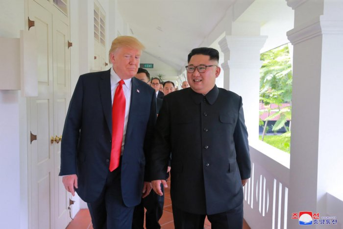 US President Donald Trump walks with North Korean leader Kim Jong Un at the Capella Hotel on Sentosa island in Singapore. Reuters File photo