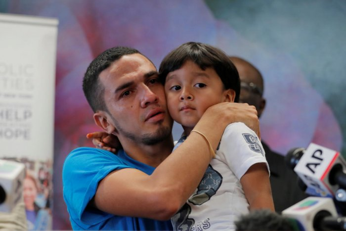 Javier, a 30 year old from Honduras, holds his 4 year old son William during a media availability in New York after they were reunited after being separated for 55 days following their detention at the Texas border, US. Reuters Photo