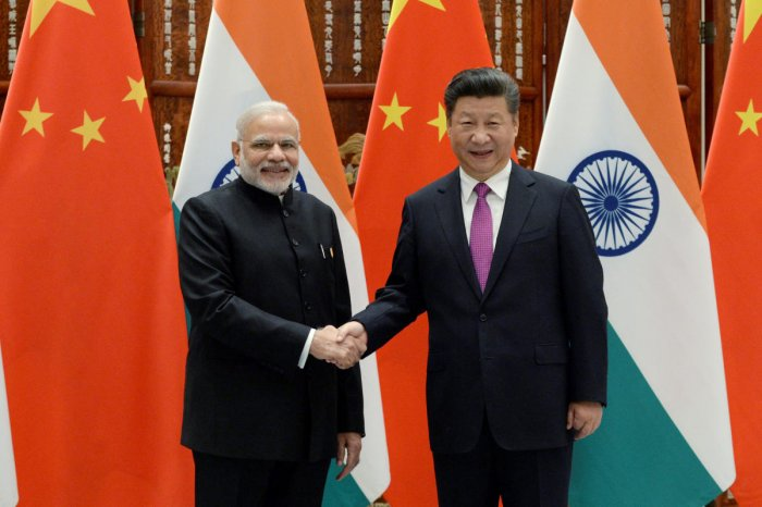 Indian Prime Minister Narendra Modi (L) shakes hands with Chinese President Xi Jinping. REUTERS File Photo.