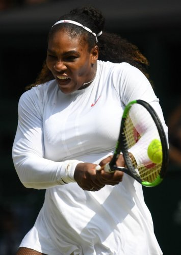 US player Serena Williams returns against Germany's Julia Goerges during their women's singles semi-final match on the tenth day of the 2018 Wimbledon Championships at The All England Lawn Tennis Club in Wimbledon, southwest London, on July 12, 2018. / AF