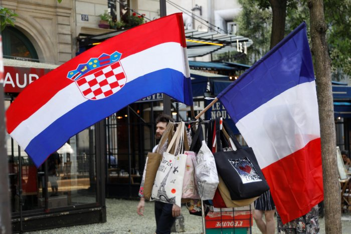A Croatian flag and a French flag on sale flies on a kiosk in Paris, prior to the upcoming World Cup final between France and Croatia, France, July 13, 2018. REUTERS.