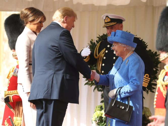 Britain's Queen Elizabeth greets U.S. President Donald Trump and First Lady Melania Trump, at Windsor Castle, Windsor, Britain July 13, 2018. (Chris Jackson/Pool via REUTERS)