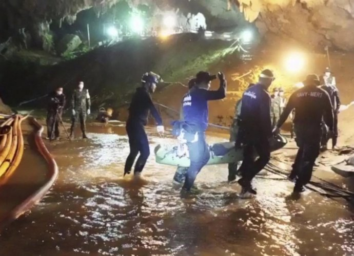 """The last group of the 12-member """"Wild Boars"""" soccer team and their coach was brought out of the Tham Luang cave, near the border with Myanmar, on Tuesday night, safely ending a dangerous rescue and evoking international relief and joy. (AP/PTI Photo)"""