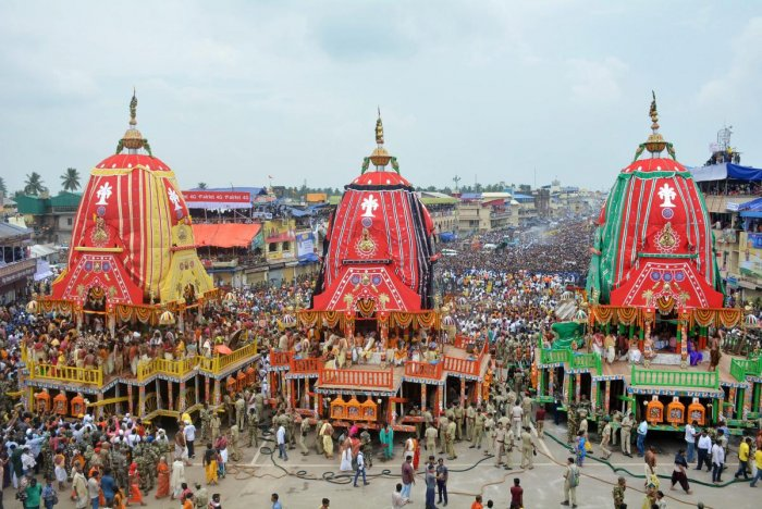 Devotees pull the chariots during the 141st Rath Yatra, in Puri on Saturday. PTI Photo