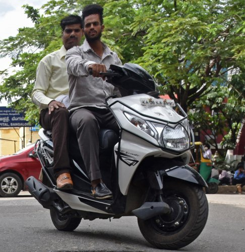The traffic police have stepped up the drive against those not wearing helmets in the city. DH file photo