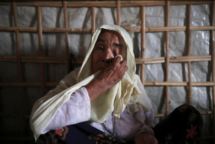 Roshan Begum, a Rohingya refugee, wipes her eyes after hearing the news that her son has been found in Buthidaung prison in Myanmar through trace message request program of Bangladesh Red Crescent Society Bangladesh, at a camp in Cox's Bazar, Bangladesh,