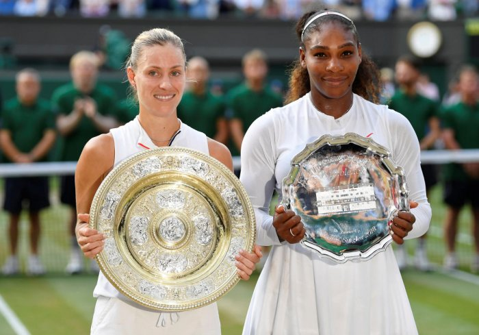 Germany's Angelique Kerber and Serena Williams of the U.S. hold their trophies after Kerber won the women's singles final. Reuters photo