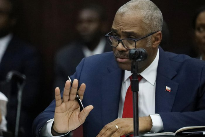 Haitian Prime minister Jack Guy Lafontant. gestures during a meeting with members of the Parliament in Port-au-Prince, Haiti, July 14, 2018. REUTERS.