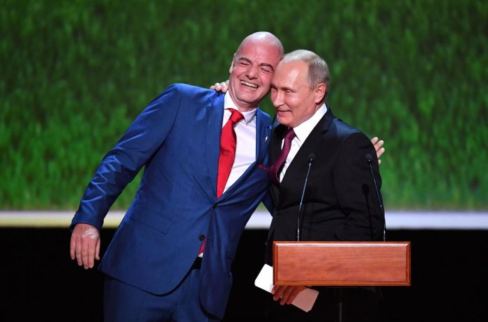 FIFA president Gianni Infantino (left) and Russian President Vladimir Putin share a laugh before a concert of opera stars in Moscow. AFP