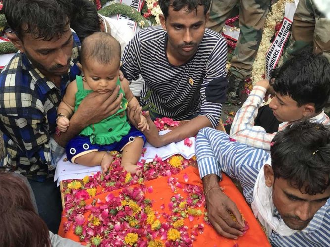 For ritual sake little Aaru held the burning stick along with her grandfather Jagannath before the latter completed the formalities of lighting the funeral pyre on Saturday. Image courtesy Twitter