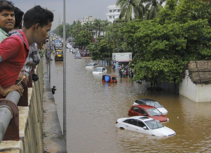 Vehicles ply at a flooded road after heavy downpour, in Bhubaneswar on Sunday, July 1, 2018. PTI file photo.