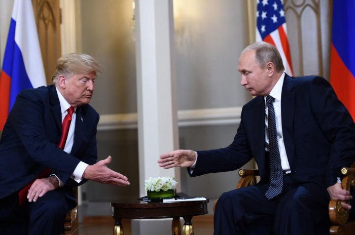 US President Donald Trump and Russian President Vladimir Putin before a meeting in Helsinki. (AFP Photo)