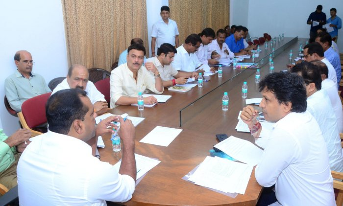 Minister for Urban Development U T Khader chairs a meeting of MLAs from Dakshina Kannada and Udupi districts on Monday.