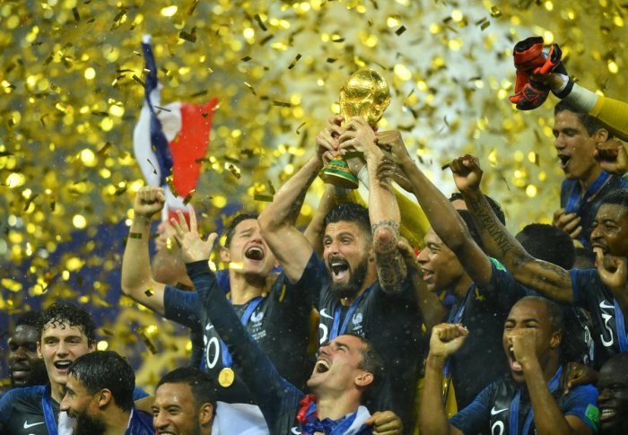 France's Olivier Giroud lifts the trophy as they celebrate winning the World Cup. (Reuters)