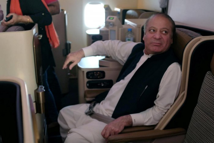 Ousted Pakistani Prime Minister Nawaz Sharif sits on a plane after landing at the Allama Iqbal International Airport in Lahore. Reuters photo