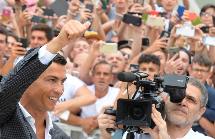 THE BOSS IS HERE! Cristiano Ronaldo gestures as he arrives at the Juventus' medical centre in Turin on Monday. Reuters