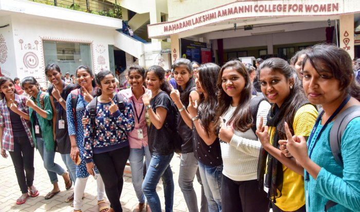 Students of the Maharani Lakshmi Ammanni College for Women show their inked fingers after the elections for the students' association on Monday. DH Photo/B H Shivakumkar