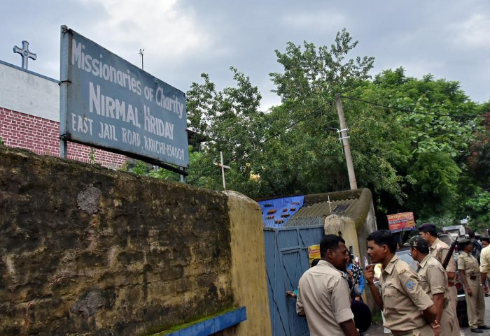 Police stand outside a home which provides shelter for pregnant unmarried women run by the Missionaries of Charity. Reuters file photo