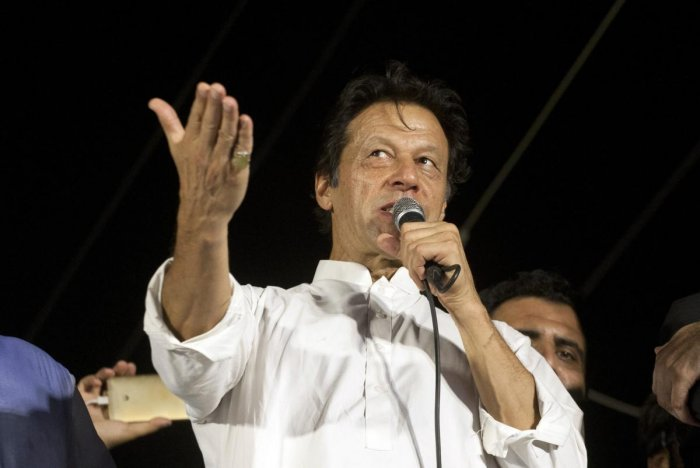 Pakistan's opposition politician Imran Khan, chief of Pakistan Tehreek-e-Insaf party, addresses his supporters during an election campaign in Karachi, Pakistan. AP/PTI file photo