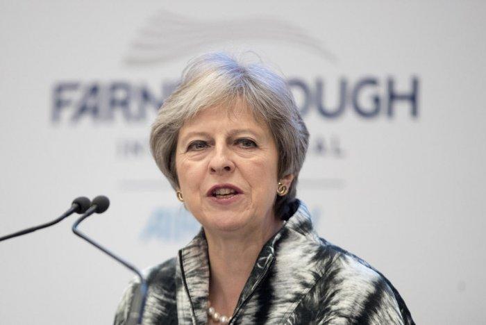 Britain's Prime Minister, Theresa May speaks at the Farnborough Airshow, in Farnborough, Britain July 16, 2018. REUTERS photo.