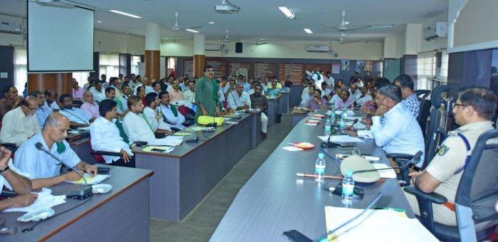 A farmer leader raises a point during farmers' meet held in Mangaluru on Friday.
