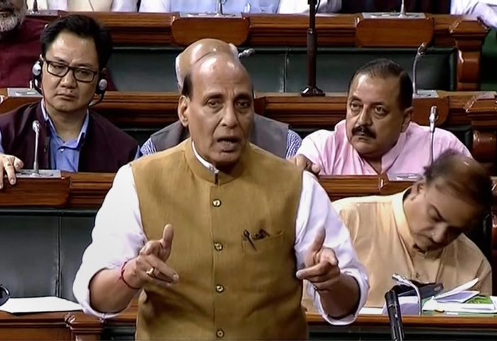 Union Home Minister Rajnath Singh speaks in the Lok Sabha on 'no-confidence motion' during the Monsoon Session of Parliament, in New Delhi on Friday. PTI photo