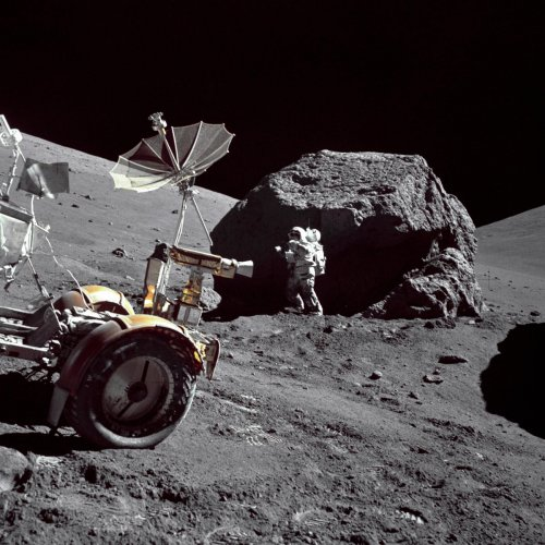 EXPEDITION: Astronaut Harrison H Schmitt at the Taurus-Littrow landing site during the third Apollo 17, EVA-3. The Rover LRV is in the left foreground. EUGENE A CERNAN/NASA