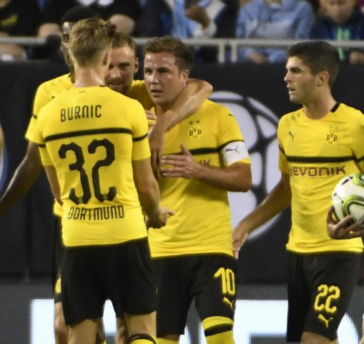 Borussia Dortmund's Mario Gotze (second from right) celebrates with team-mates after scoring against Manchester City on Friday. AFP