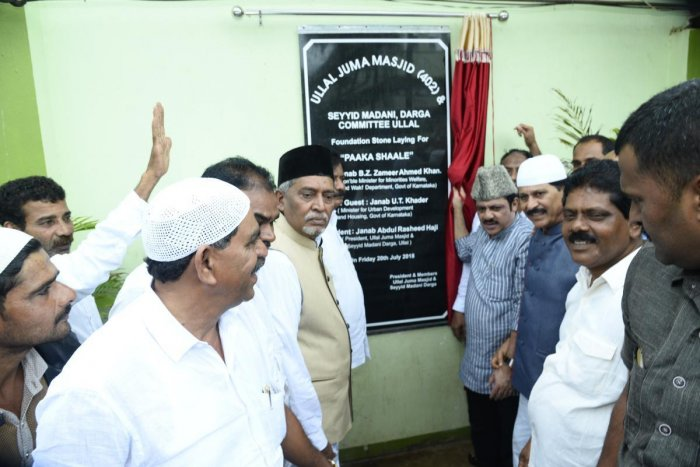 Minister for Food and Civil Supplies and Wakf Zameer Ahmed unveils the plaque to mark the laying of the foundation stone for the kitchen at Ullal Dargah on Friday.