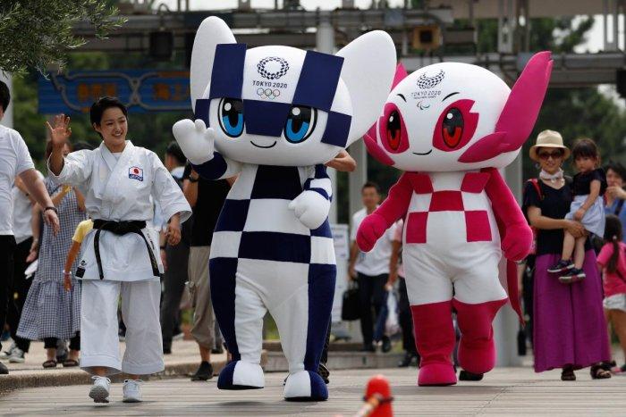 Tokyo 2020 Olympics mascot Miraitowa (centre) and Paralympic mascot Someity wave with Japanese karateka Kiyo Shimkizu (left) in Tokyo on Sunday. AFP