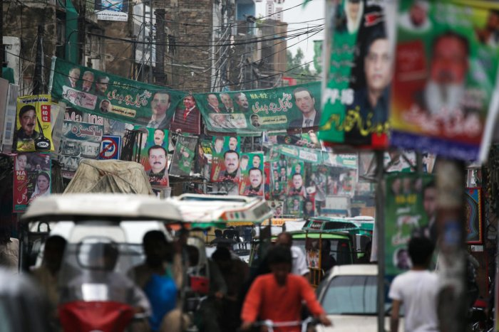 A street is decorated with flags and banners of political parties ahead of a general election in Rawalpindi. Reuters photo