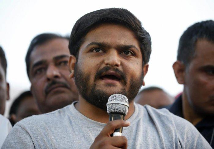 PAAS convener Hardik Patel addresses people during a protest. PTI file photo