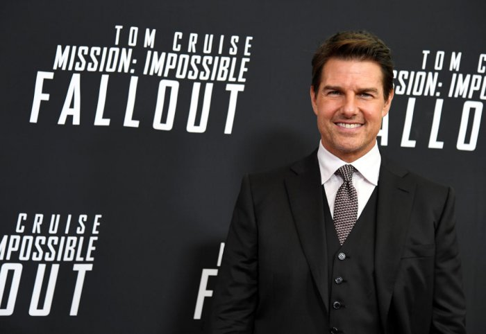 Actor Tom Cruise poses for photographers as he arrives on the red carpet for the premiere of Mission:Impossible-Fallout, at the Smithsonian's National Air and Space Museum, in Washington. Reuters photo