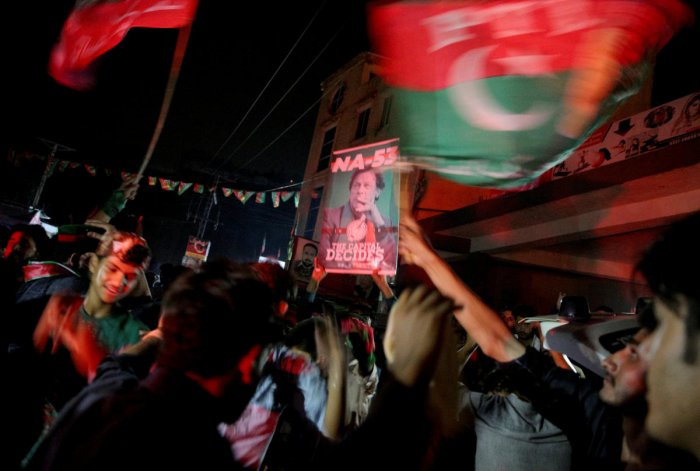 Supporters of Imran Khan, chairman of the Pakistan Tehreek-e-Insaf political party, celebrate near his residence in Bani Gala during the general election, in Islamabad, Pakistan July 25, 2018. Reuters
