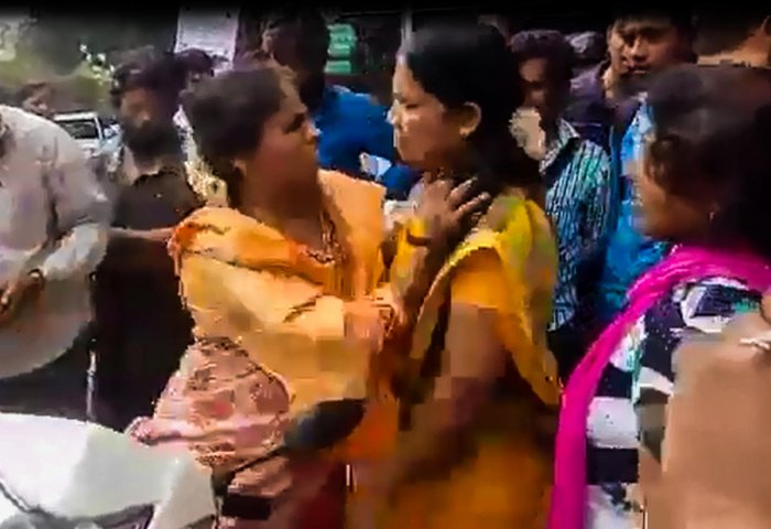 A TV grab shows a Gujarati woman arguing with Kannada activists near Hessaraghatta on Thursday afternoon.