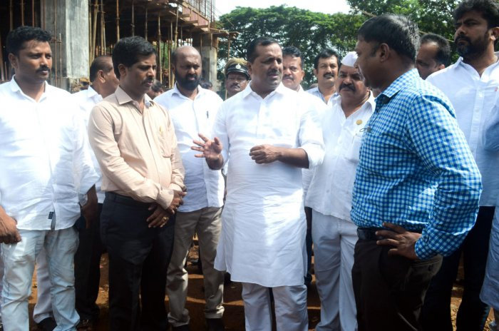 Urban Development and Housing Minister U T Khader visits the site of the new DC office complex at Padil on Friday and reviews the progress of the work.DC Sasikanth Senthil, Additional Deputy Commissioner Kumar and other officers look on.