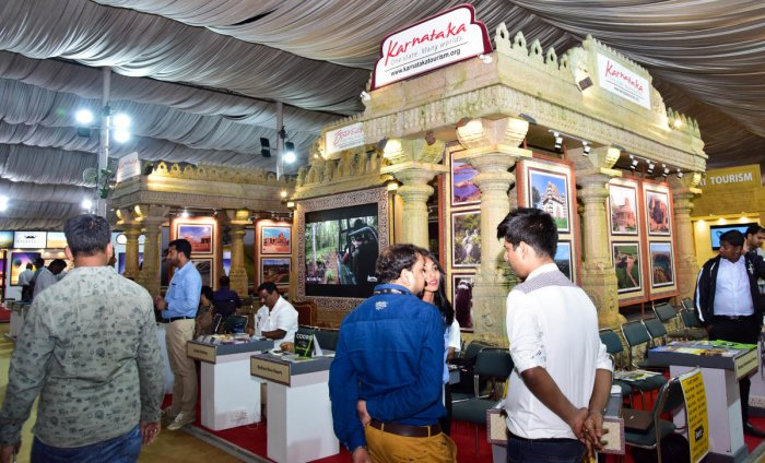Visitors seen at the India premier Travel and Tourism Exhibition at Palace Grounds, organised by India International Travel Mart, in Bengaluru on Friday. Photo/ B H Shivakumar