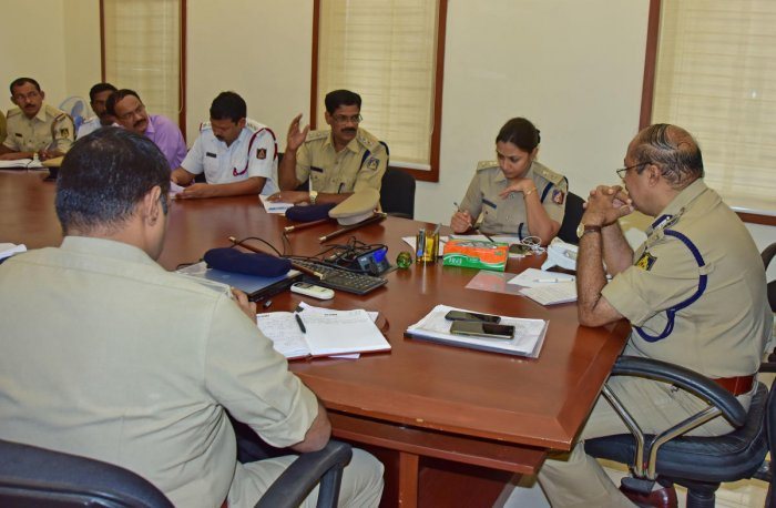 City Police Commissioner T R Suresh and other police officials during phone in programme in Mangaluru on Friday.