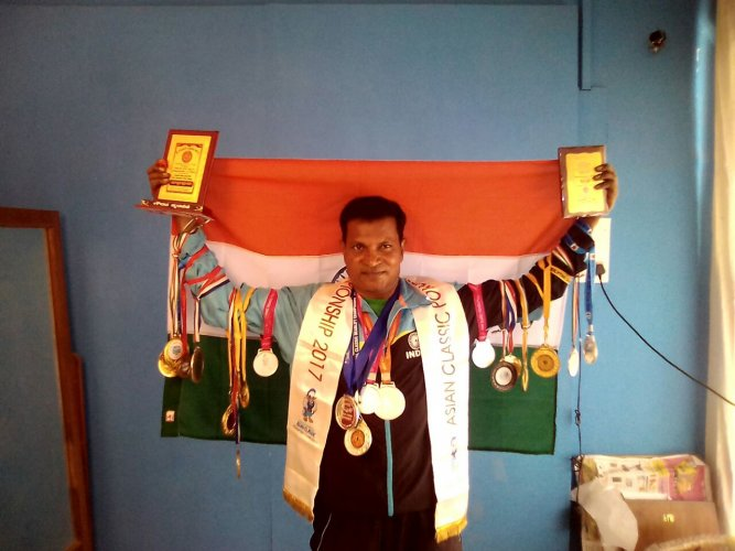 N Eshwara has 50 gold medals for powerlifting.