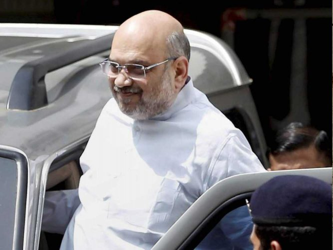 Three people, including two women, were detained for allegedly waving black flags and jumping in front of BJP chief Amit Shah's convoy, police said on Saturday. PTI file photo