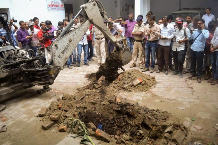 Police investigate the site where a rape victim was allegedly buried, at a government shelter home in Muzaffarpur, on Monday, July 23, 2018. A girl of the home has alleged that one of her fellow inmates was beaten to death and buried at the premises of th