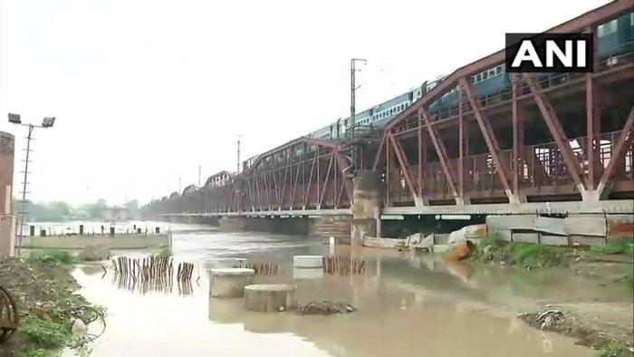 ANI/Twitter photo of the Yamuna river overflowing.