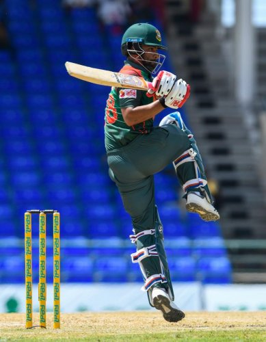 CLASSY: Tamim Iqbal of Bangladesh sends one to the fence en route his 103 against West Indies at Basseterre on Saturday. AFP
