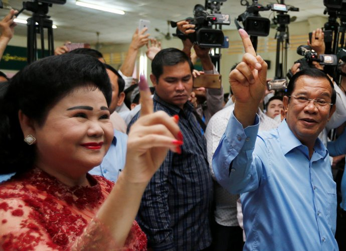 Cambodia's Prime Minister and President of the Cambodian People's Party (CPP) Hun Sen and his wife Bun Rany show their stained fingers at a polling station during a general election in Takhmao, Kandal province, Cambodia July 29, 2018. Reuters