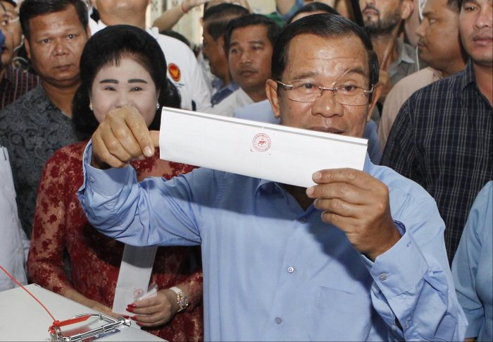 Cambodian Prime Minister Hun Sen holds his ballot at a polling station in Takhmua, Kandal province, southeast of Phnom Penh, Cambodia, Sunday, July 29, 2018. AP/ PTI file photo.