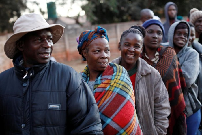 Zimbabwean voters queue to cast their ballots in the country's general elections in Harare, Zimbabwe on Monday. (REUTERS/Mike Hutchings)