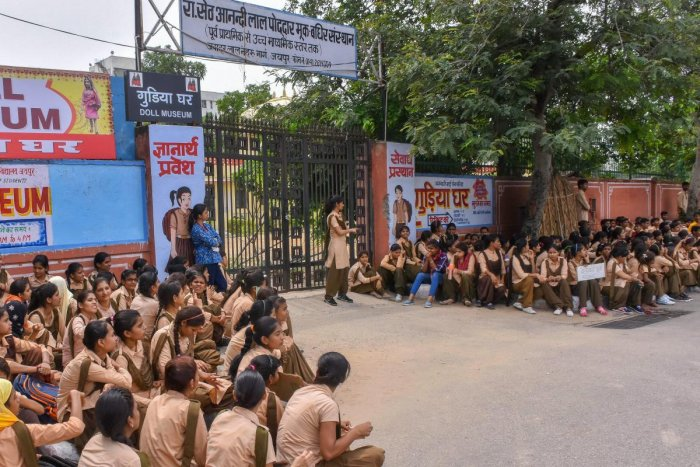 Students of Government Secondary School for Deaf & Dumb stage a demonstration outside their school to highlight their problems, at JLN road in Jaipur on Monday. (PTI Photo)