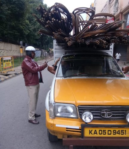 A traffic policeman checks a goods vehicle for violations.