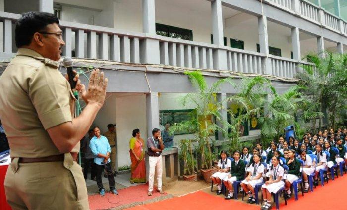 ACP Kasim Raja speaks at a road safety programme at The Indiranagar Cambridge School in New Thippasandra on Monday.
