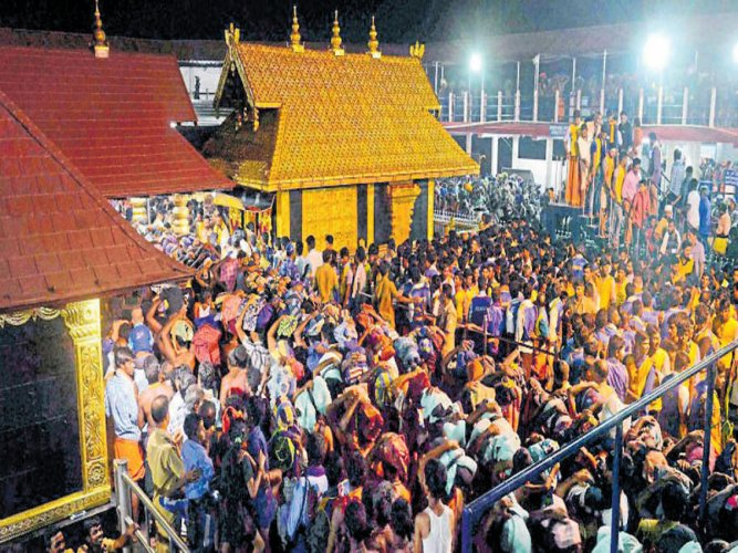 """The apex court had on October 13 last year referred the issue to a Constitution bench after framing five """"significant"""" questions including whether the practice of banning entry of women into the temple amounted to discrimination and violated their fundamental rights under the Constitution. (PTI file photo)"""